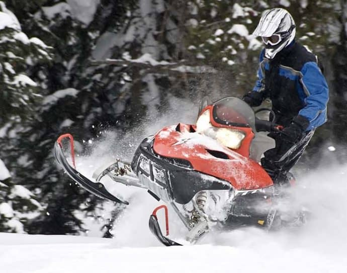 Man Snowmobiling in Snowmass, Colorado